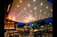 سایبان پارچه ای بازشونده کافه رستوران- سقف چادری رستوران عربی- پوشش بازشوفست فود-سقف تاشو رستوران مراکشی-سایبان بازشونده باغ تالار-سایبان