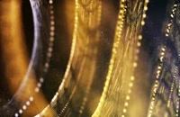 ویدیو فوتیج پارتیکل های طلایی رنگ